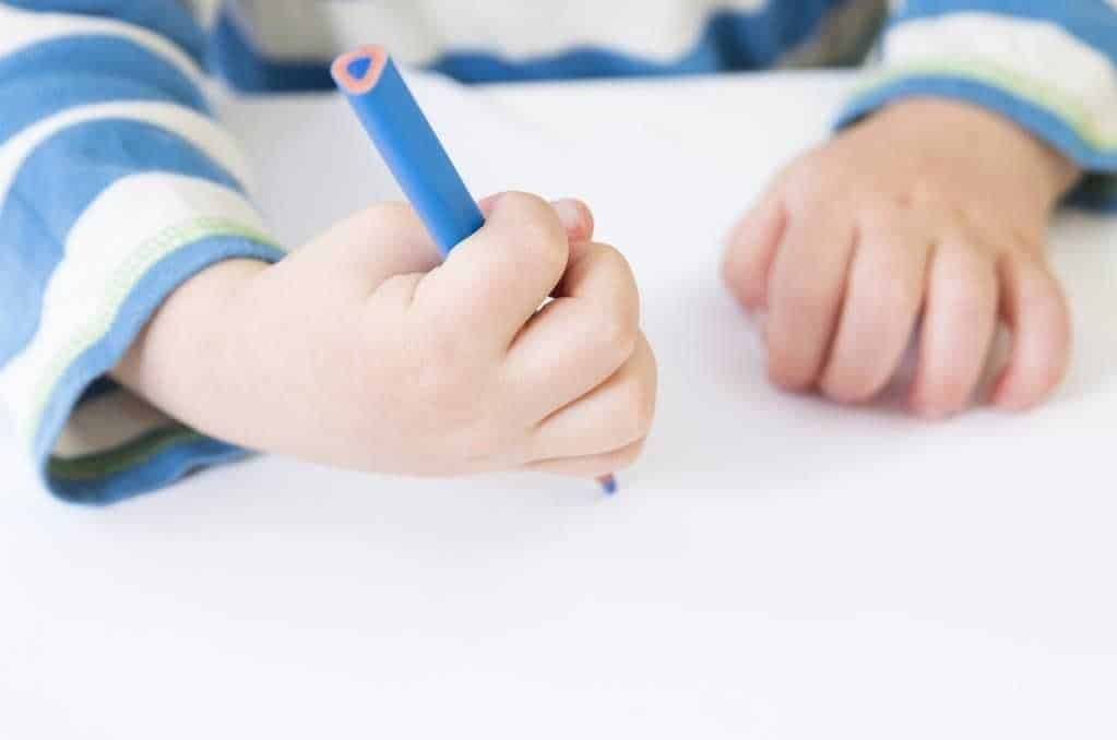 What age does a child start to scribble?