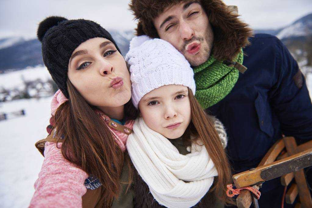 Is it OK to kiss family on the lips?