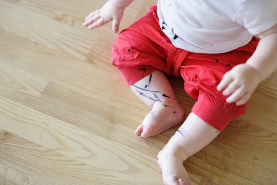 why does my child draw on themselves?